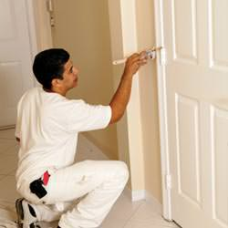 An interior painting contractor detailing a home with paint in Redding
